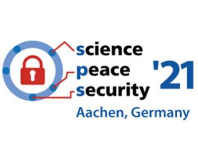 Auf dem Foto ist das Logo einer Tagung zu sehen.